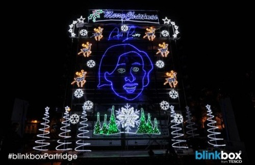 Alan Partridge's giant neon face lights up Norwich for Christmas