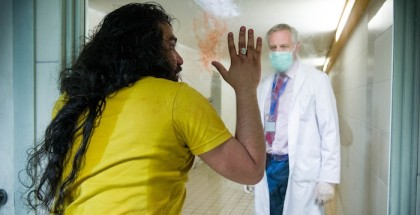 Programme Name: Cordon - TX: n/a - Episode: n/a (No. 1) - Picture Shows: Anwar Utman Kel, the first patient diagnosed with virulent flu-like symptoms under the observation of Dr Cannaerts head of the National Institute of Infectious Diseases Anwar Utman Kel (MOKHALLAD RASEM), Dr Cannaerts (JOHAN VAN ASSCHE) - (C) Medialaan - Photographer: -