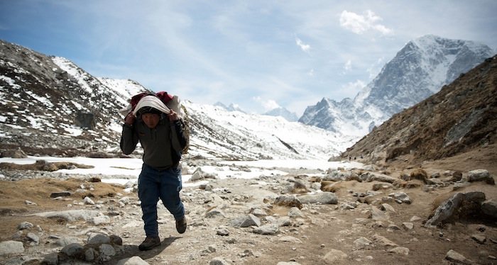 Programme Name: Earth's Natural Wonders: Living On The Edge - TX: 05/08/2015 - Episode: Earth's Natural Wonders - ep 1 (No. n/a) - Picture Shows: Sherpa carrying kit to base camp, Everest - (C) BBC - Photographer: BBC