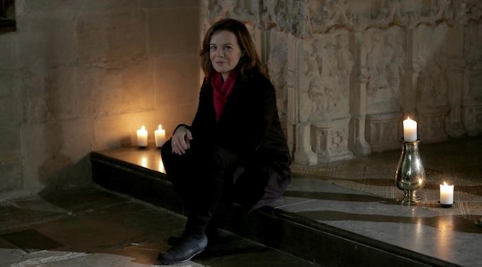 Presenter Helen Castor sat next to Shakepeare's grave.
