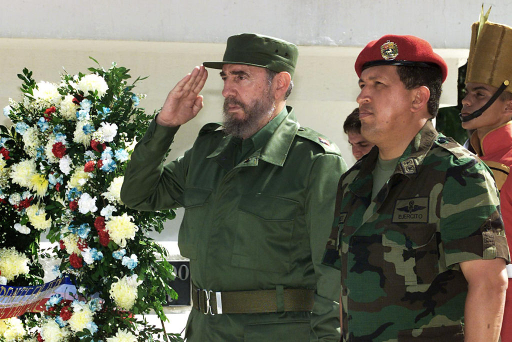 The Cuban President Fidel Castro (L) and Venezuelan President Hugo Chavez (R) salutes during thier visit to unknow soldier monument in Campo Carabobo, Valencia, Venezuela, 29 October 2000. Castro is on 5-day official visit to Venezuela. El presidente cubano Fidel Castro (I) y el de Venezuela, Hugo Chavez (D) saludan mientras colocan una ofrenda  floral en el monumento al soldado desconocido en el monumento de Campo Carabobo, Valencia, Venezuela, el 29 de octubre de 2000. Castro realiza una visita oficial de 5 dias a Venezuela donde ha visitado lugares historicos, sociales y deportivos acompanado de Chavez.  AFP PHOTO / Adalberto ROQUE        (Photo credit should read ADALBERTO ROQUE/AFP/Getty Images)