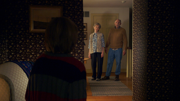 (L to R) Tyler (ED OXENBOULD) is terrified by Nana (DEANNA DUNAGAN) and Pop Pop (PETER MCROBBIE) in Universal Pictures' The Visit.  Writer/Director/ Producer M. Night Shyamalan returns to his roots with the terrifying story of a brother and sister who are sent to their grandparents' remote Pennsylvania farm for a weeklong trip.  Once the children discover that the elderly couple is involved in something deeply disturbing, they see their chances of getting back home are growing smaller every day.